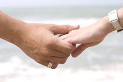 Hand Holding in Sea Background Stock Images