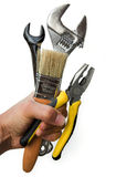 Hand holding a selection of tools Royalty Free Stock Photos