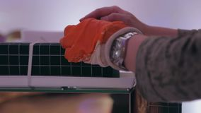 Hand holding self lock plastic cable stock video footage