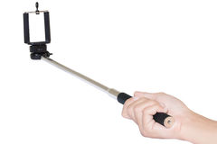 Hand holding selfie stick isolated with clipping path on white b Stock Photos