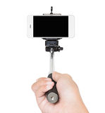 Hand holding selfie stick isolated white clipping path Stock Photography