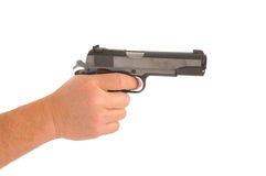 Hand holding semi-automatic pistol Royalty Free Stock Image