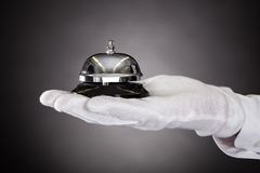 Hand Holding Service Bell Royalty Free Stock Photo