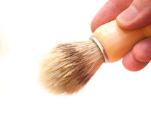 Hand holding a shaving brush Royalty Free Stock Photography