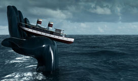 Hand holding the ship out of the water. The concept of the crash Stock Photography