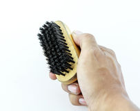Hand holding shoe brush isolated Royalty Free Stock Photography