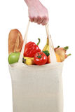 Hand holding a shopping bag filled with groceries Royalty Free Stock Photography