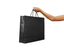 Hand holding shopping bag Stock Photos