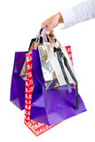 Hand holding shopping bags Stock Images