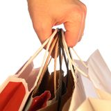 Hand Holding Shopping Bags Stock Photo