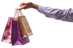 Hand holding shopping bags with christmas shopping on white back Stock Photos