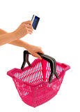 Hand holding a shopping basket and a credit card. Stock Photography