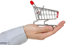 Hand holding shopping cart Royalty Free Stock Photos