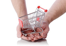 Hand holding shopping trolly Royalty Free Stock Photography