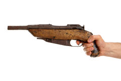 Hand holding shotgun Royalty Free Stock Photo