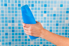 Hand holding shower gel Royalty Free Stock Photography