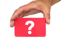 Hand holding and showing a red card with  QUESTION MARK  Stock Images