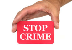 Hand holding and showing a red card with  STOP CRIME  text. Royalty Free Stock Photo