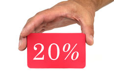 Hand holding and showing a red card with  20%  text Royalty Free Stock Photos