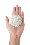 Hand holding shredded paper. Isolated on white background Stock Photos