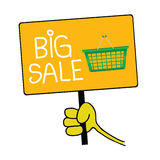 Hand holding a sign with message for big sale Stock Images