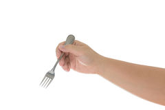 Hand holding a silver fork  isolated on white. Hand holding a silver fork isolated on white  background with clipping path Stock Photos