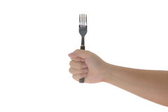Hand holding a silver fork  isolated on white. Hand holding a silver fork isolated on white  background with clipping path Stock Photo