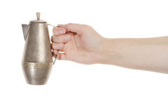 Hand holding silver jug Royalty Free Stock Photography