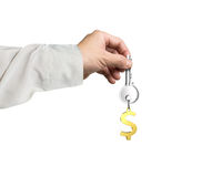 Hand holding silver key with golden dollar sign shape keyring Royalty Free Stock Photo