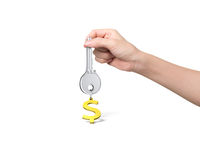 Hand holding silver key with golden dollar sign shape keyring Stock Photos