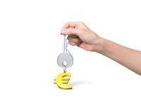 Hand holding silver key with golden euro sign shape keyring Royalty Free Stock Images