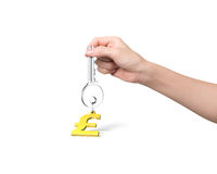 Hand holding silver key with golden pound symbol shape keyring Stock Photo