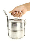 A hand holding silver metal tiffin Stock Images