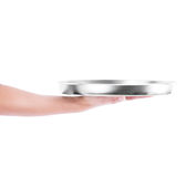 Hand holding silver tray Royalty Free Stock Photos