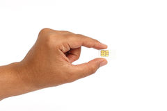 Hand holding sim card isolated on white background Stock Images