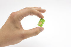 Hand holding sim card Royalty Free Stock Image