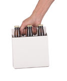 Hand holding a six pack of beer bottles Royalty Free Stock Photos