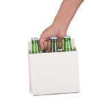 Hand holding a six pack of beer bottles royalty free stock photography