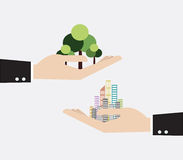 Hand holding skyscraper and tree Stock Images