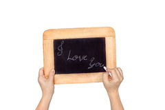 Hand holding slate blackboard with the text:I love you,isolated Royalty Free Stock Images