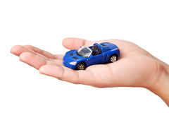 Hand holding small blue car. Isolated on white Royalty Free Stock Image