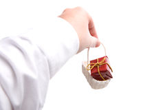 Hand holding small christmas present. Isolated on white background Royalty Free Stock Photos