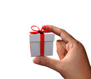 Hand holding small gift Stock Photo