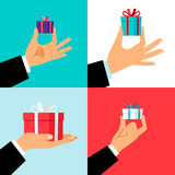 Hand holding small gift box set. Hands giving presents for offering or christmas concepts. Vector illustration Stock Photo