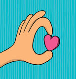 Hand holding small heart / Love stock illustration