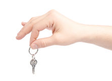 Hand holding a small key Stock Image