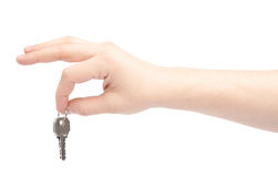 Hand holding a small key Stock Photography