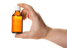 Hand holding small medicine bottle Royalty Free Stock Photos