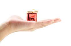 Hand holding a small red gift box Stock Photography