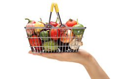 Hand holding a small shopping basket Royalty Free Stock Images